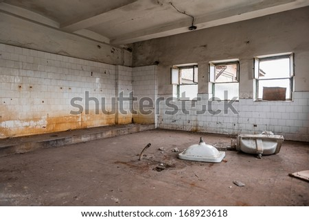 Old tiled wall of an industrial building - stock photo