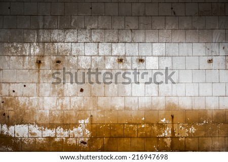 Old tiled wall of an industrial building interior - stock photo