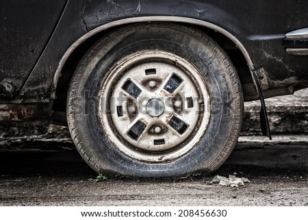 Old tire breaking - stock photo