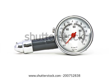 Old Tire gauge on white background - stock photo