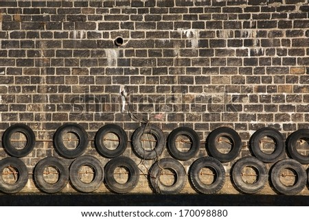 Old tires in port - stock photo