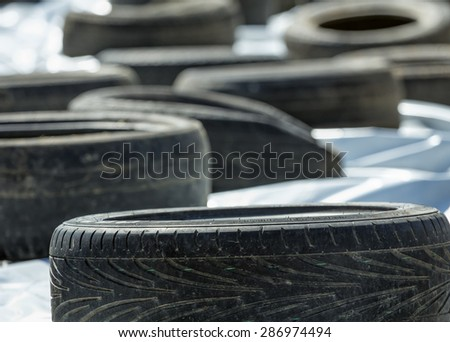 Old tires on light fabric background - stock photo