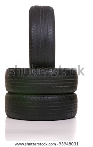 old tires stacked isolated on white background