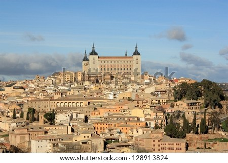 Old Toledo town, former capital of Spain. Famous Alcazar. - stock photo
