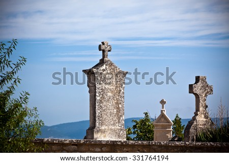 Old tombstones at an antique european cemetery. Horizontal shot - stock photo