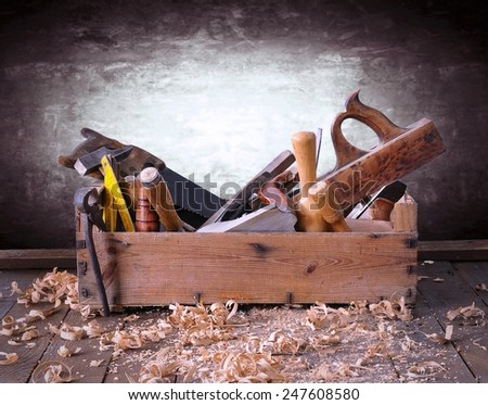 Old toolbox on the workbench in a carpentry - stock photo