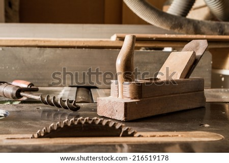 old tools and current tools(rotary saw, drill, plane) - stock photo