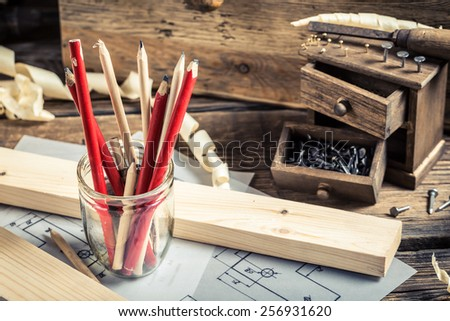 Old tools in carpentry workshop - stock photo