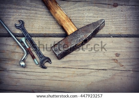 Old tools on a wood background