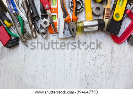 Old tools on a wooden table - stock photo