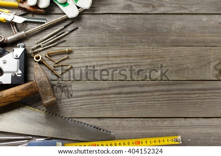 old tools on a wooden table with copy space for text - stock photo
