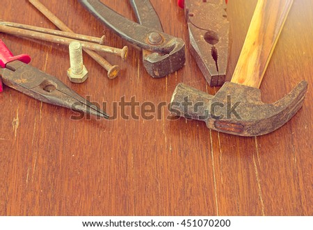 Old tools on wood background, old equipment concept, vintage and retro tone style - stock photo
