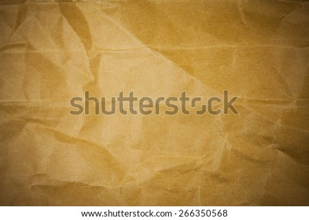 Old torn crumpled paper bag texture background. - stock photo