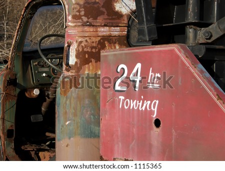 Old Tow Truck with 24 Hour Towing - stock photo