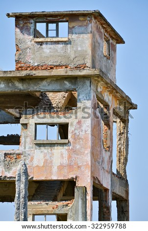 Old tower destroyed and abandoned as a hazardous wreck - stock photo
