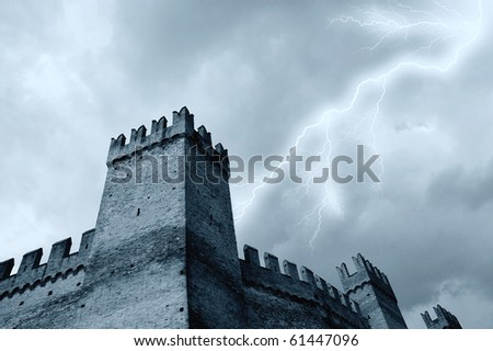 old tower under the storm - stock photo