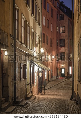 Old Town alley in Stockholm, Sweden at night. - stock photo