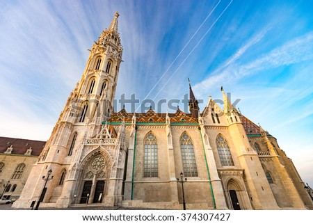 Old town architecture of Budapest. Buda temple church of Matthias. Buda's Castle District. Blue cloudy sky in background. Hungary, Europe.