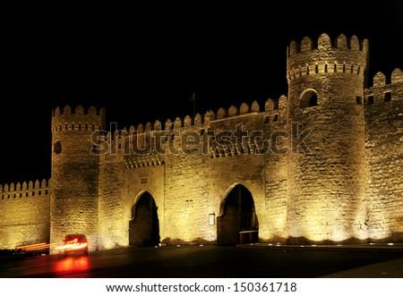 old town gate in baku azerbaijan by night - stock photo