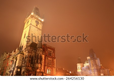 Old Town Hall Tower and St Nicholas Church in foggy autumn night, Prague, Czech Republic - stock photo