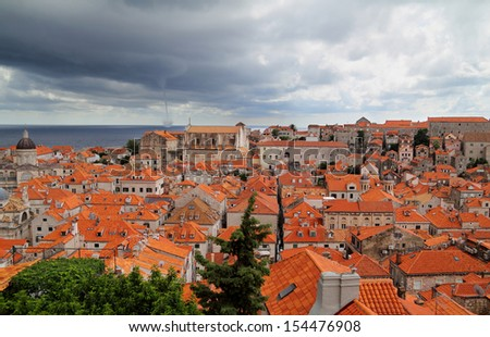 Old town in city of Dubrovnik with whirlwind at sea - Croatia - stock photo