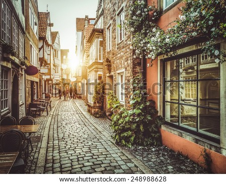 Old town in Europe at sunset with retro vintage Instagram style filter and lens flare effect - stock photo