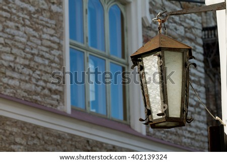 Old town lantern with old brick wall at the background