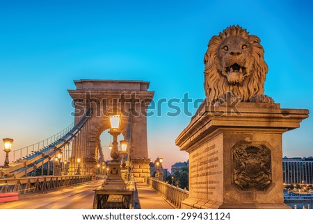 Old Town of Budapest, Hungary. Famous spectacular The Szechenyi Chain Bridge in the astonishing sunrise of summer. One of most representative landmarks of beautiful Hungarian capital city.  - stock photo