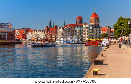 Old Town of Gdansk, Dlugie Pobrzeze and Motlawa River in the morning, Poland - stock photo