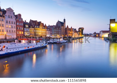 Old town of Gdansk with ancient crane at night, Poland - stock photo