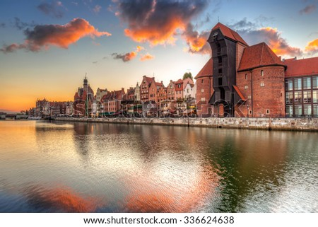 Old town of Gdansk with ancient crane at sunset, Poland - stock photo