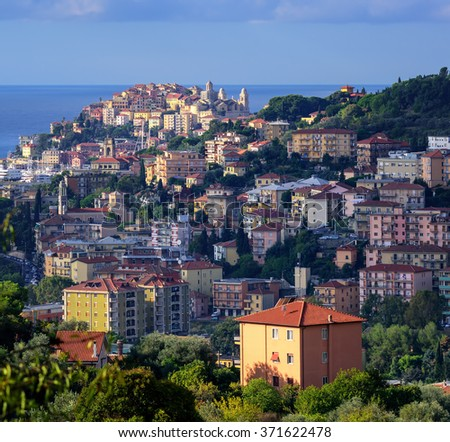 Old town of Imperia on the green hills of Maritime Alps mountains on italian Riviera, Liguria, Italy - stock photo