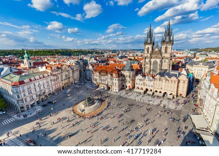 Old Town of Prague, Czech Republic. View on Tyn Church and Jan Hus Memorial on the square as seen from Old Town City Hall. Blue sunny sky - stock photo
