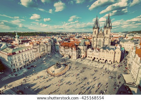 Old Town of Prague, Czech Republic. View on Tyn Church and Jan Hus Memorial on the square as seen from Old Town City Hall. Vintage - stock photo