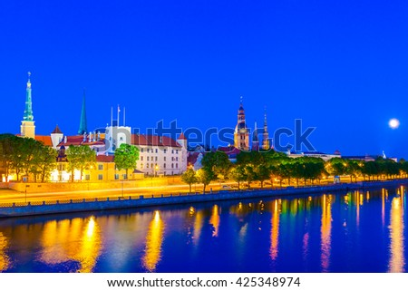Old Town of Riga with reflection in Daugava River at night, Riga castle, Riga Cathedral, Saint Peters Church. Riga, Latvia - stock photo