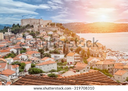 Old town of Sibenik in Croatia at sunset - stock photo