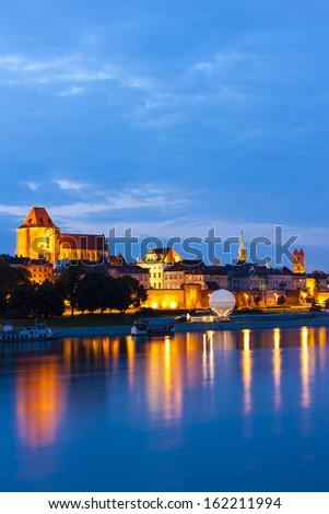 Old town of Torun at night, Kuyavia-Pomerania, Poland - stock photo