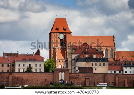 Old Town of Torun in Poland, houses, city wall fortification, Cathedral Basilica of St. John the Baptist and St. John the Evangelist.