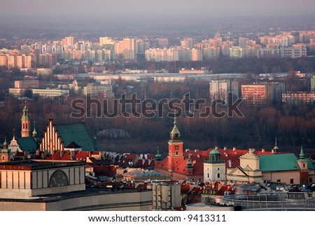 Old town of Warsaw on the first plane, modern residential districts in the background. Photo taken from the top of Palace of Culture and Science. - stock photo
