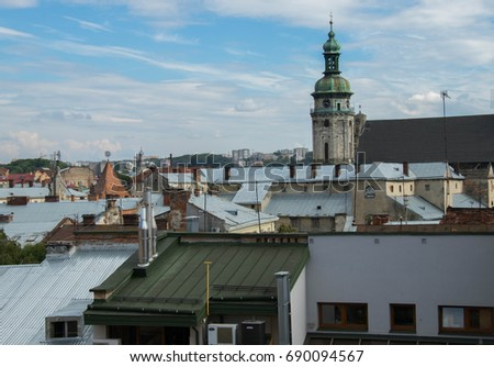 old town roofs against bright Summer sky