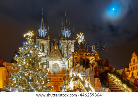 Old Town Square with Christmas tree and fairy tale Church of our Lady Tyn in the magical city of Prague at moonlight night, Czech Republic