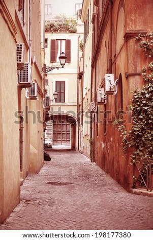 Old town street and Mediterranean architecture in Rome, Italy. Cross processed color style - retro image filtered tone.