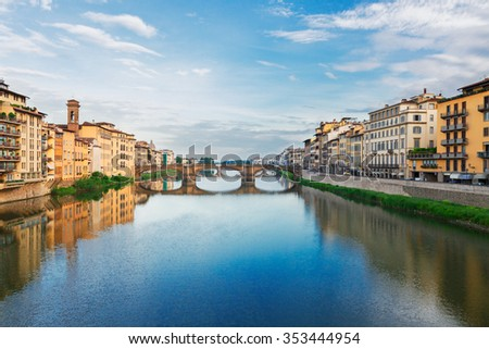 old town with bridge Santa trinita reflecting in water of river Arno, Florence, Italy - stock photo