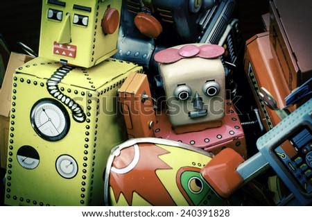 old toy box of tin toys  - stock photo