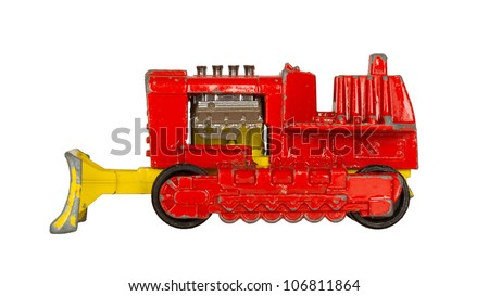 Old toy car (bulldozer, 1970) isolated on white - stock photo