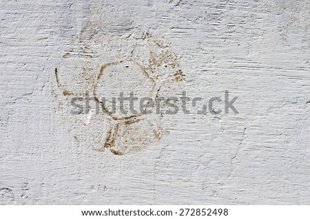 Old track of the ball on the wall. textural composition - stock photo