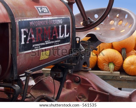 old tractor and pumpkins - stock photo