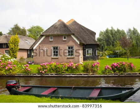 old traditional dutch house in giethoorn - stock photo
