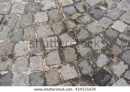 Old  traditional european style cobblestone road texture background with granite blocks, stones and brickwork pattern - stock photo