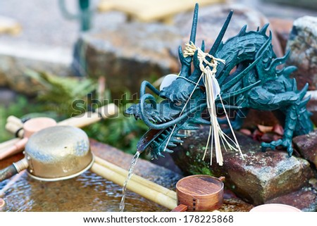 Old traditional japanese dragon fountain in buddhist shrine  in Nagoya, Japan  - stock photo